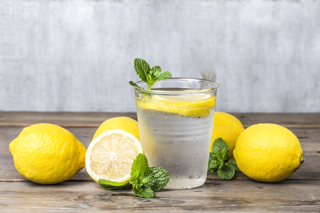 Homemade lemonade with fresh lemon and mint